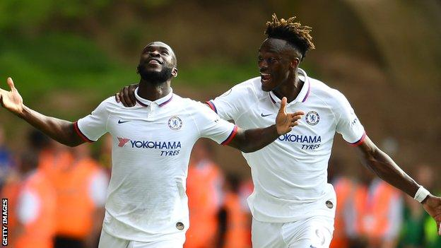 Fikayo Tomori and Tammy Abraham celebrate a goal for Chelsea together