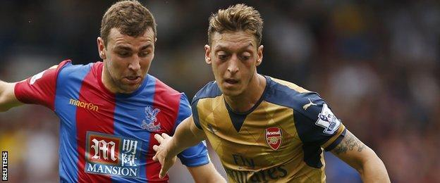 Mesut Ozil (right) in action against Crystal Palace