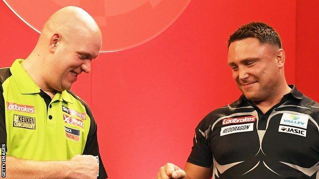 Michael van Gerwen and Gerwyn Price fist-bump ahead of a game