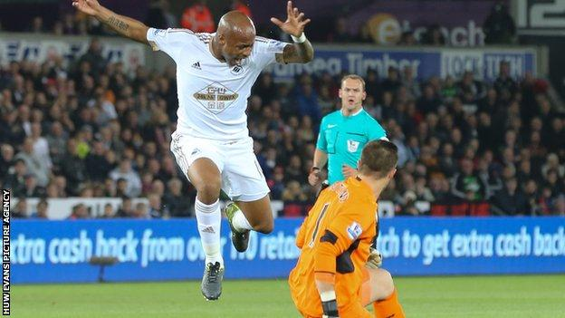 Swansea forward Andre Ayew took evasive action to avoid the challenge of Stoke's Jack Butland