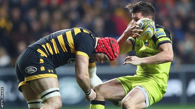 James Haskell suffers a head injury in a tackle on Leicester's Freddie Burns