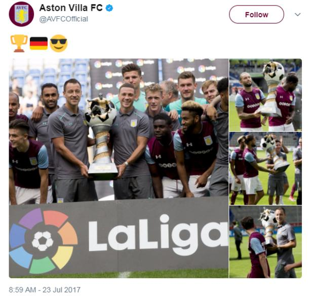 Aston Villa holding the Cup of Traditions