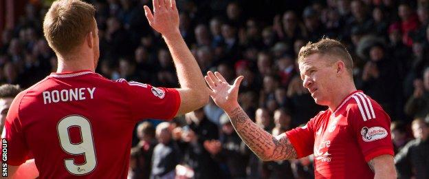 Adam Rooney congratulates Jonny Hayes