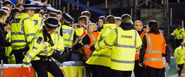 Police and stewards had to step in to deal with trouble in the away end at Cappielow