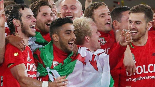 Neil Taylor (third from left) celebrates Euro 2016 qualification along with Wales team-mates, including Gareth Bale (left) and Aaron Ramsey (right)
