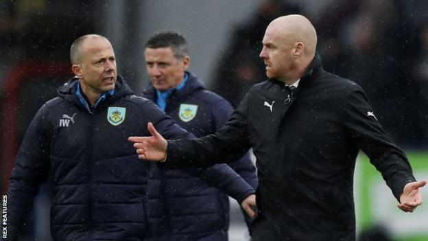 Burnley boss Sean Dyche (right) walks to the dressing room after their defeat by Leicester