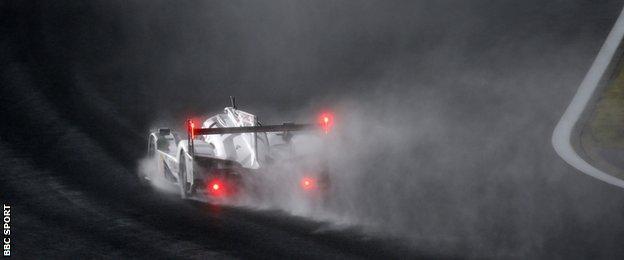 Mark Webber drives his Porsche in the rain at Fuji