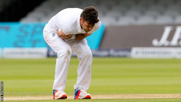 England's James Anderson holds his injured shoulder against Sri Lanka at Lord's