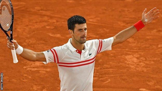 Novak Djokovic celebrates beating Rafael Nadal in his semi-final