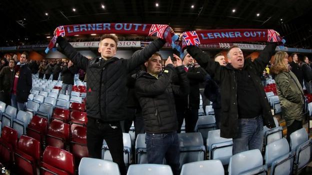Aston Villa fans vent their anger at owner Randy Lerner