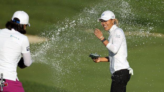 Danielle Kang is sprayed with champagne