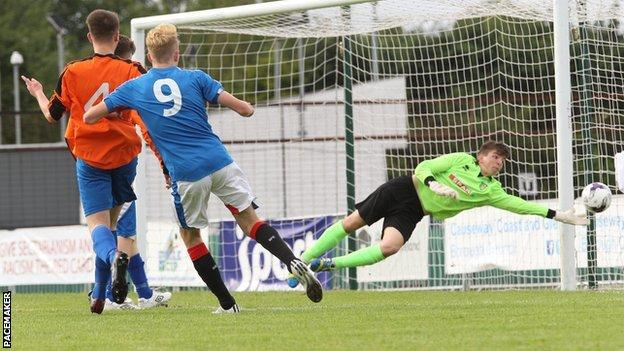 Zac Rudden scores one of his three goals against County Fermanagh at Ballymena Showgrounds