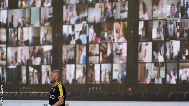 Screens with fans are shown during the Danish Superliga game between AGF Aarhus and Randers FC