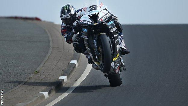 Michael Dunlop pulls a 'wheelie' at Black's Hill on his way to setting the fastest Superbike time in practice