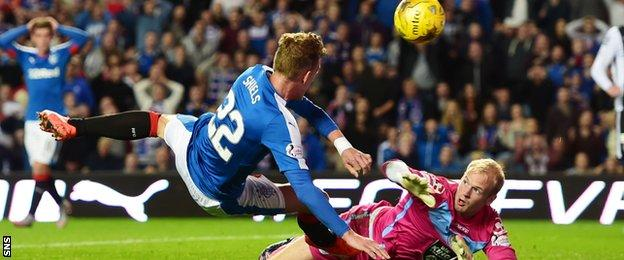 Dean Shiels bundled in a third after his initial shot was saved by Mark Ridgers