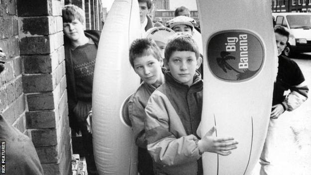 A young Manchester City fan with an inflatable banana in 1989