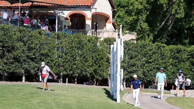 Fans watch the action at Colonial Country Club from a makeshift grandstand