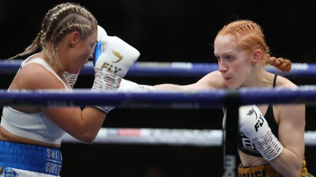 Shannon Courtenay (left) puts her hands up in defence as Rachel Ball (right) punches