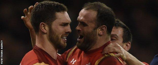 George North and Jamie Roberts celebrate against Scotland