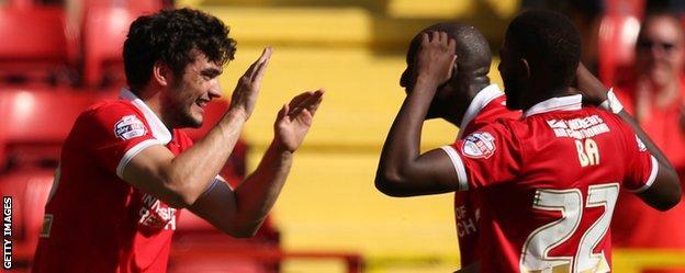 Tony Watt (left) celebrates his goal for Charlton against QPR
