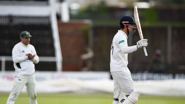 Alastair Cook acknowledges his 17th first-class century for Essex - and the 54th of his career