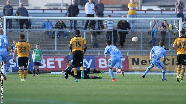 Paul Mullin sends Newport goalkeeper Joe Day the wrong way from the spot