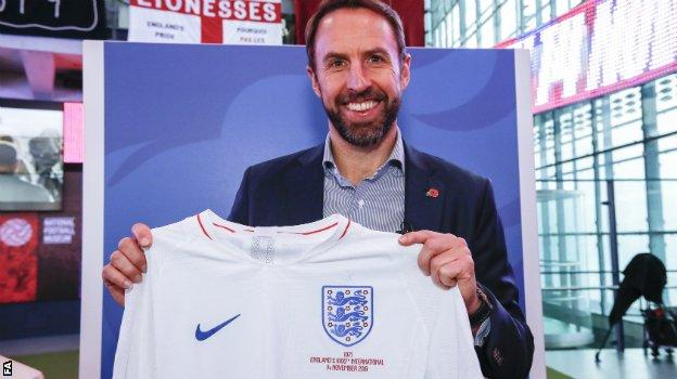 England boss Gareth Southgate with his own England shirt and legacy number - 1071
