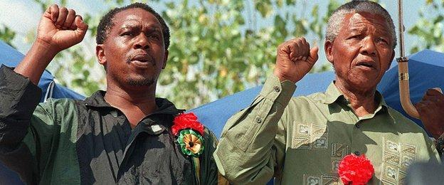 Tokyo Sexwale, left, alongside Nelson Mandela at a peace rally in South Africa in 1994