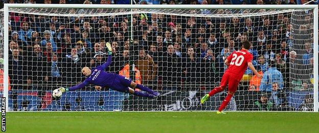 Manchester City goalkeeper Willy Caballero keeps out Adam Lallana's penalty