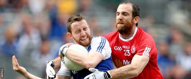 Tyrone sub Justin McMahon challenges Monaghan's Owen Duffy