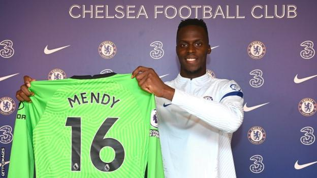 Senegal goalkeeper Edouard Mendy holding up his Chelsea shirt