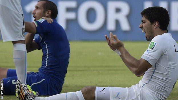 Italy Giorgio Chiellini and Uruguay's Luis Suarez