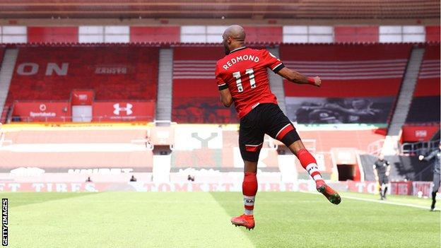 Nathan Redmond of Southampton celebrates after putting his team 3-2 up during the Premier League match between Southampton and Burnley at St Mary's Stadium on April 04, 2021