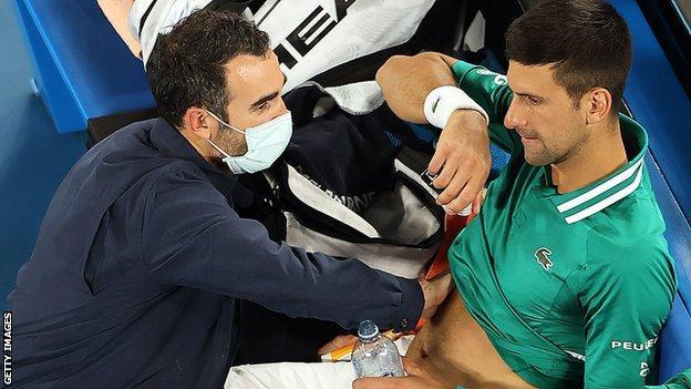 Novak Djokovic with the physiotherapist