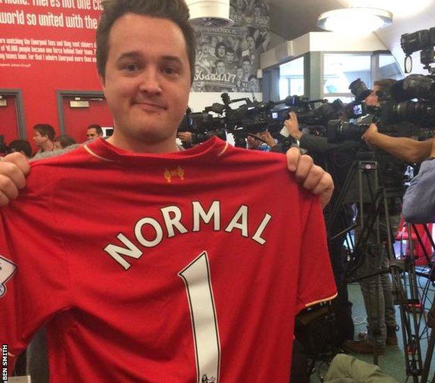 Norwegian journalist with Normal 1 shirt
