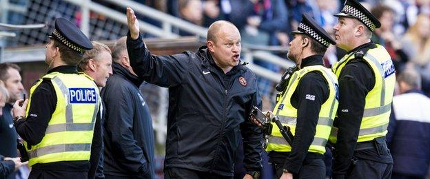 Dundee United boss Mixu Paatelainen gestures to police over abuse he claimed he received from Dundee fans