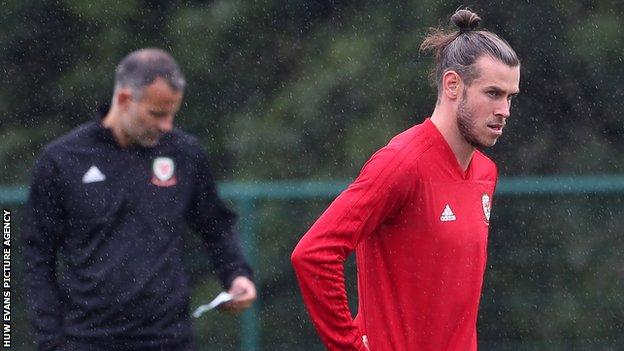 Gareth Bale in training with Wales under the watchful eye of Ryan Giggs