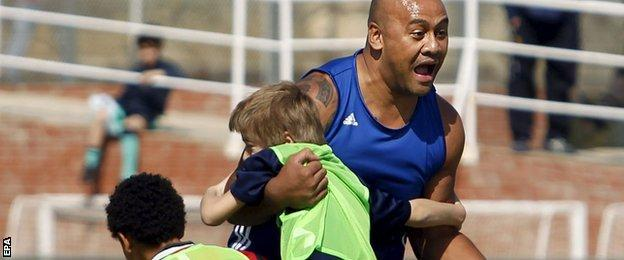 Jonah Lomu in a training session with young fans