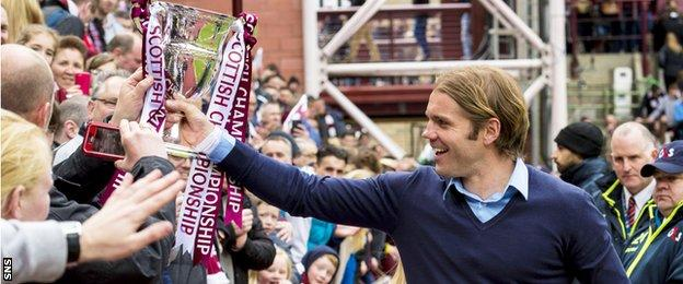 Robbie Neilson parades the Scottish Championship trophy before Hearts fans