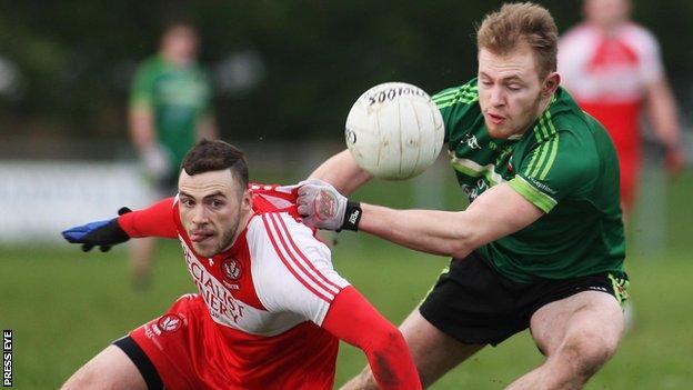 Derry's Daniel McKinless battles with QUB's Gerard McGovern in last year's McKenna Cup match at Greenlough