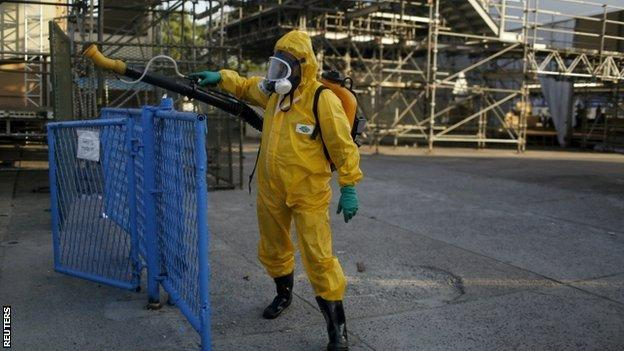 A Rio municipal worker sprays insecticide