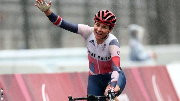 Sarah Storey celebrates crossing the line