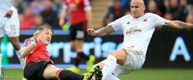 Jonjo Shelvey (right) tackles Manchester United's Bastian Schweinsteiger