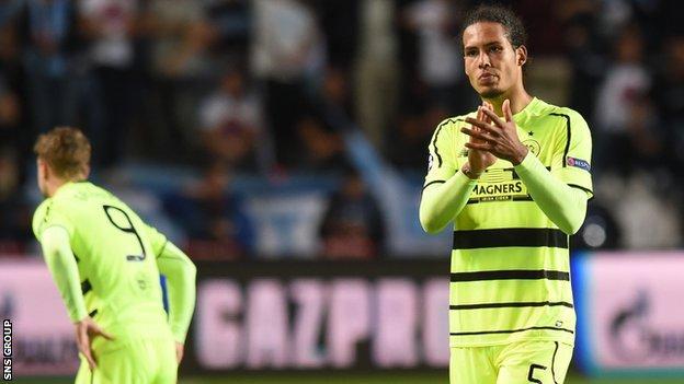 Virgil van Dijk applauds Celtic fans after the 2-0 defeat in Malmo