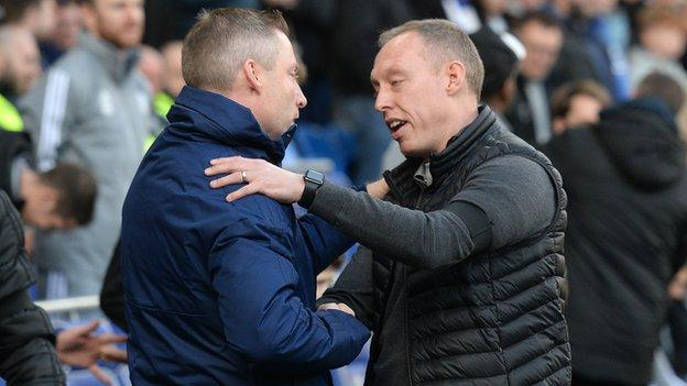 Neil Harris and Steve Cooper shake hands after the South Wales Derby