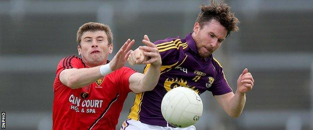Down's Luke Howard battles with Wexford's Ben Brosnan during the All-Ireland qualifier in late June