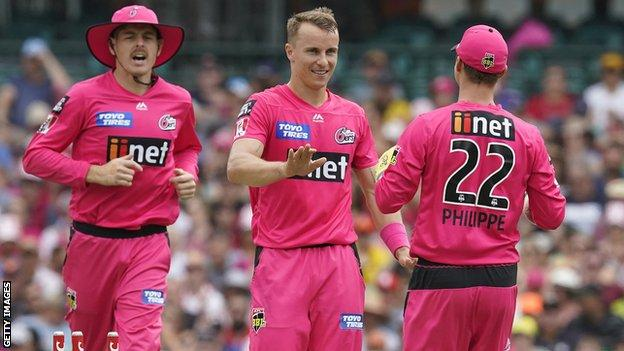 Tom Curran celebrates taking a wicket for Sydney Sixers in the Australian Big Bash League
