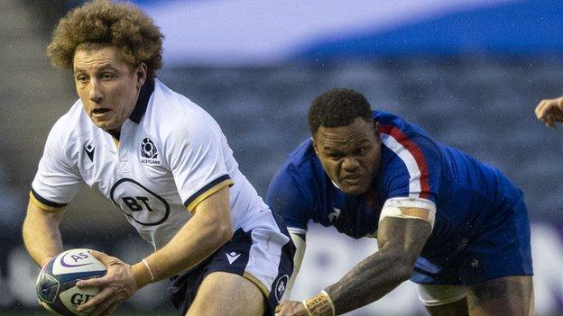 Scotland's Duncan Weir drives forward away from France's Virimi Vakatawa