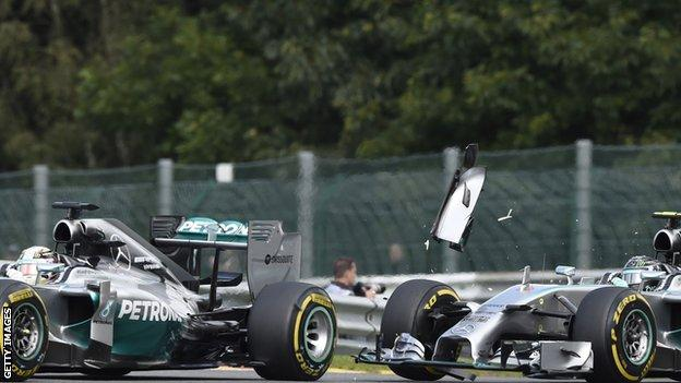 Lewis Hamilton and Nico Rosberg collide at twh 2014 Belgain Grand Prix