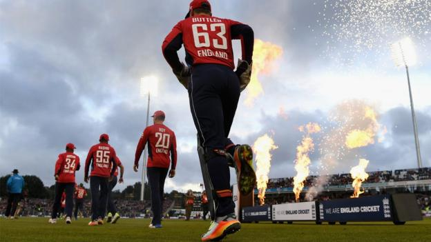 Jos Buttler runs out to join his England team-mates for the T20 against West Indies at Chester-le-Street